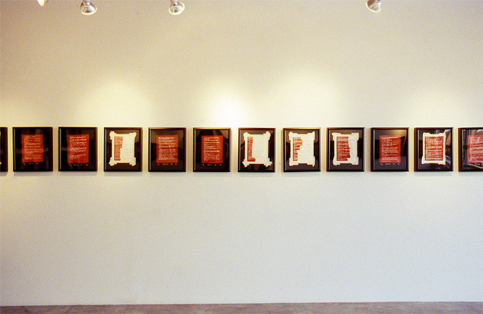 2002 11 08 Indian Acts Indian Act Nadia Myre Beaded exhibition roll 2 019 installation shot showing west wall row of framed images